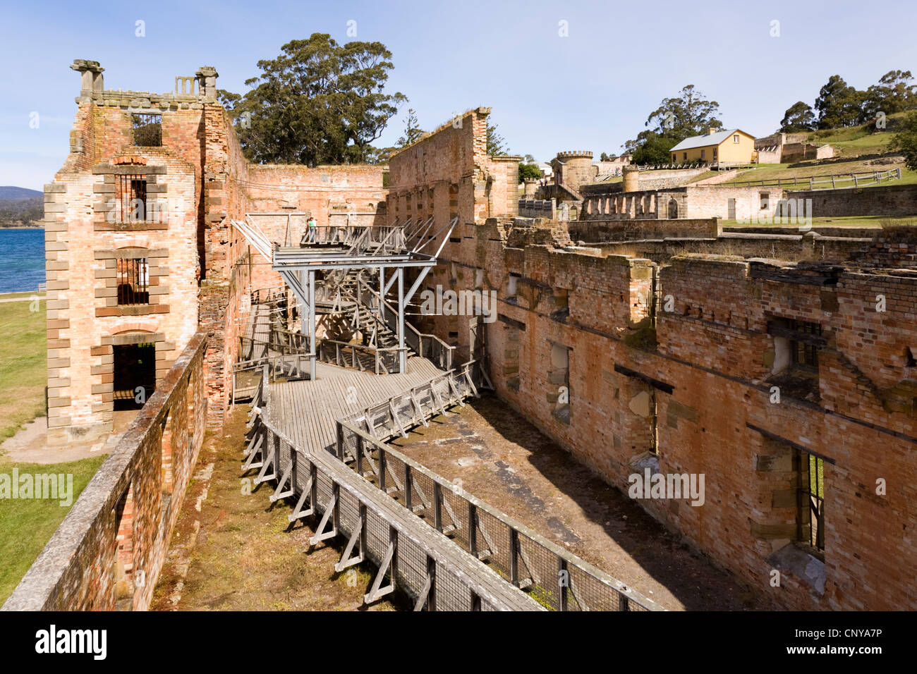 The ruins of Port Arthur Penitentiary, Tasmania, Australia. A walkway for tourists has been built for access. - Stock Image