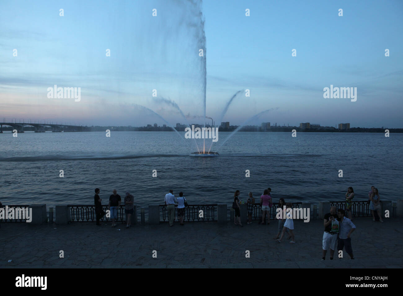 Embankment of the Dnieper River in Dnipro (Dnipropetrovsk), Ukraine. The Petrovsky Metallurgic Plant is seen in - Stock Image