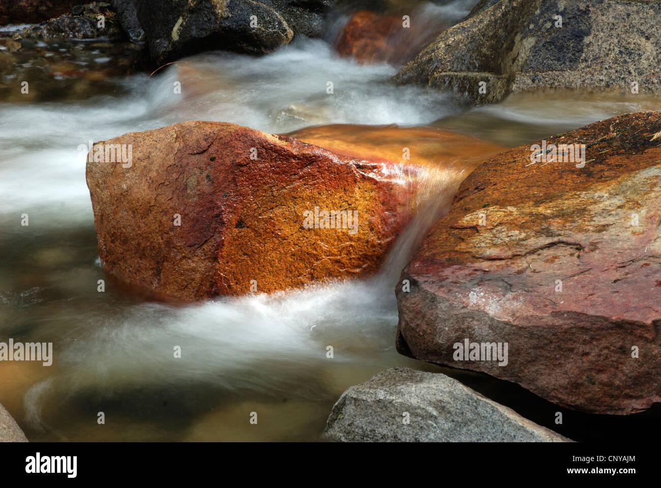cascading water below Bridal Vail Falls, Yosemite Valley, Yosemite National Park, red stones, soft water - Stock Image