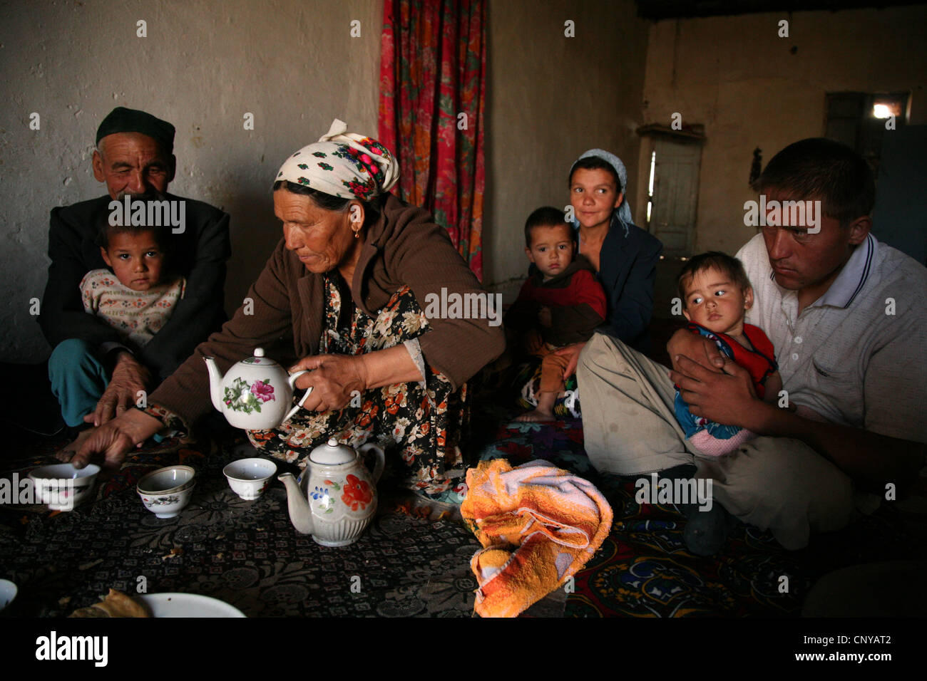 Tea drinking in a Kazakh family living in a kishlak beside the Uzbek-Turkmen border near Khiva, Uzbekistan. Stock Photo