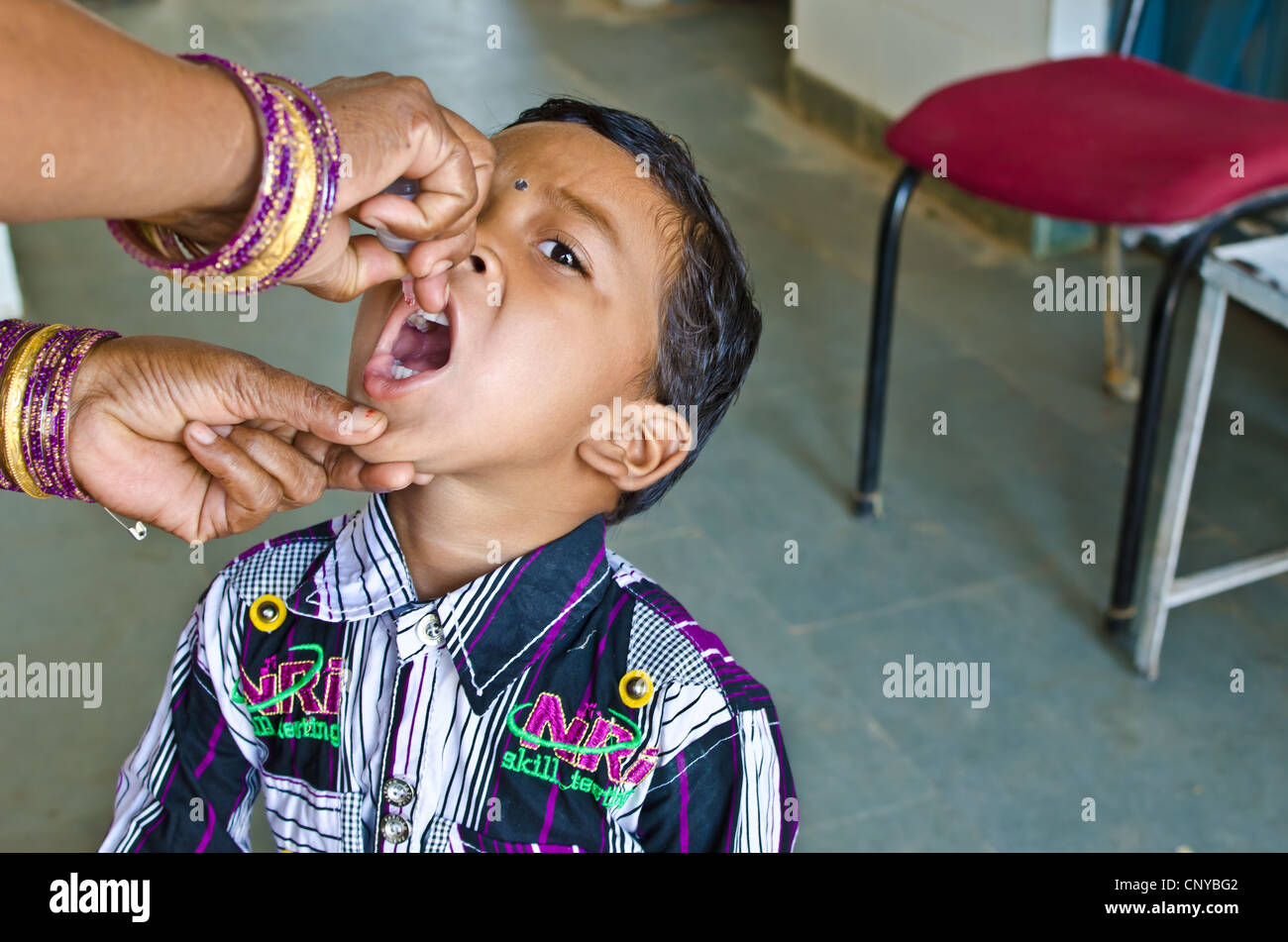 Oral polio vaccination - Stock Image