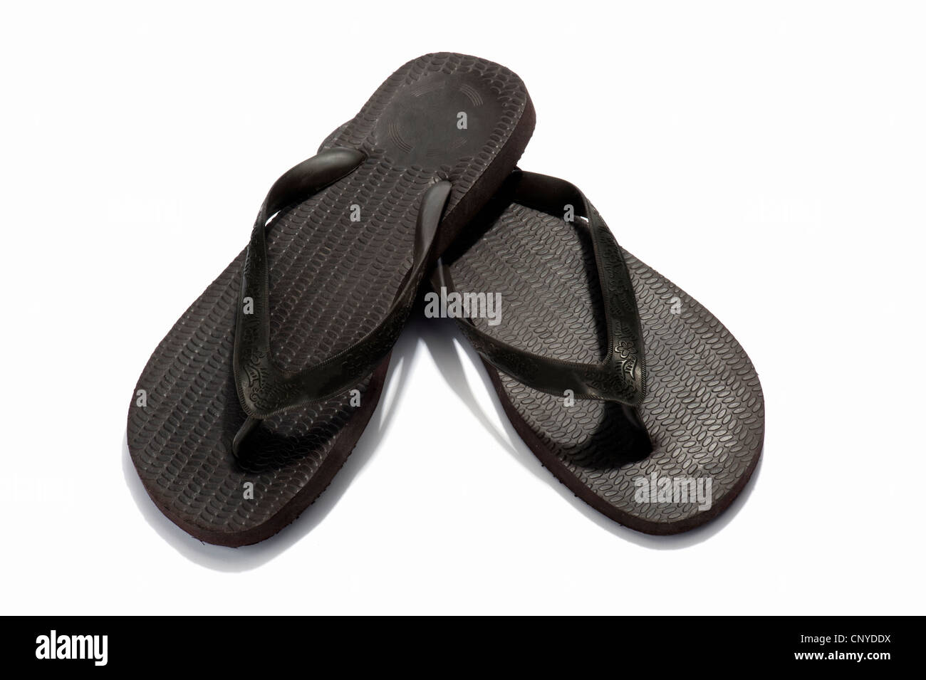 A pair of black flip flops - Stock Image