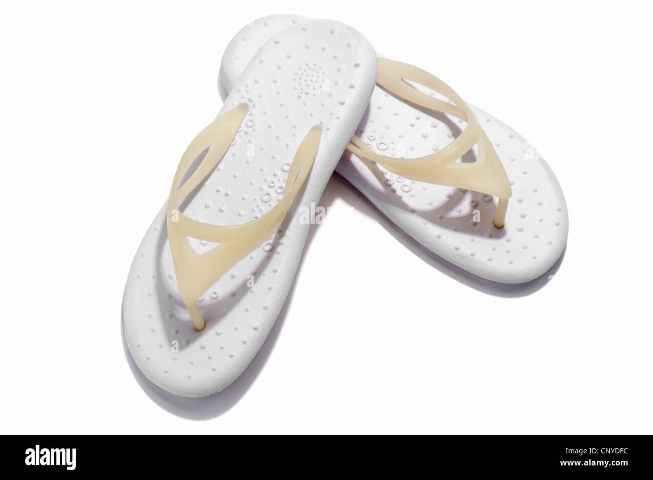 A pair of white flip flops - Stock Image