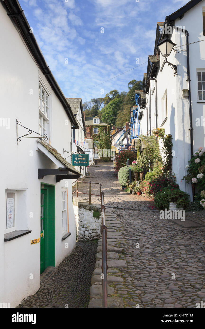 View up the steep narrow cobbled street in quaint village of Clovelly, North Devon, England, UK, Britain. - Stock Image