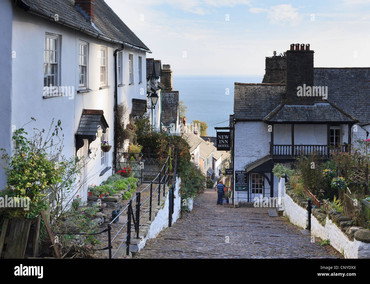 View to the sea down steep narrow cobbled street in quaint old village of Clovelly, North Devon, England, UK, Britain - Stock Image