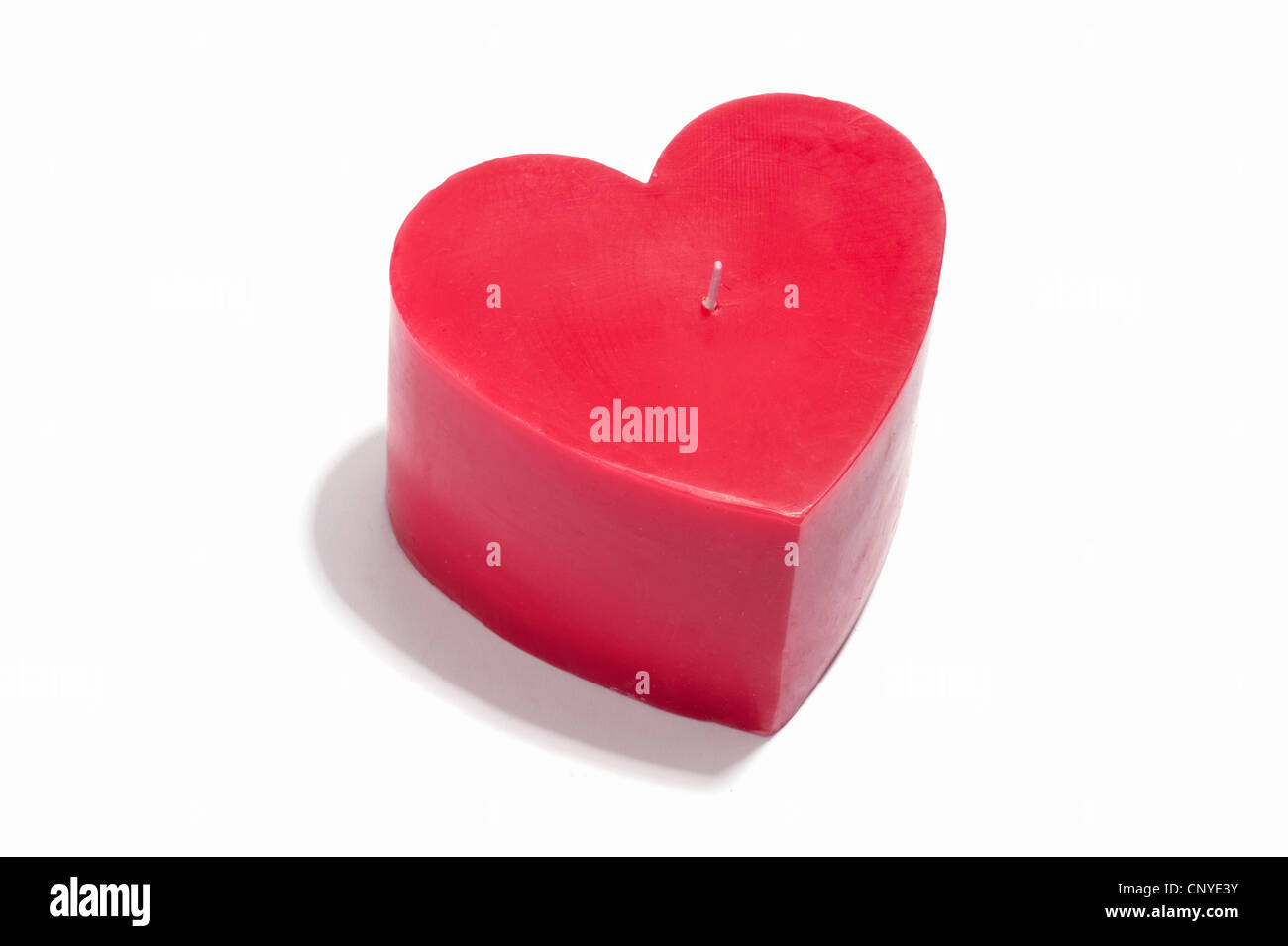 A red heart shaped candle - Stock Image