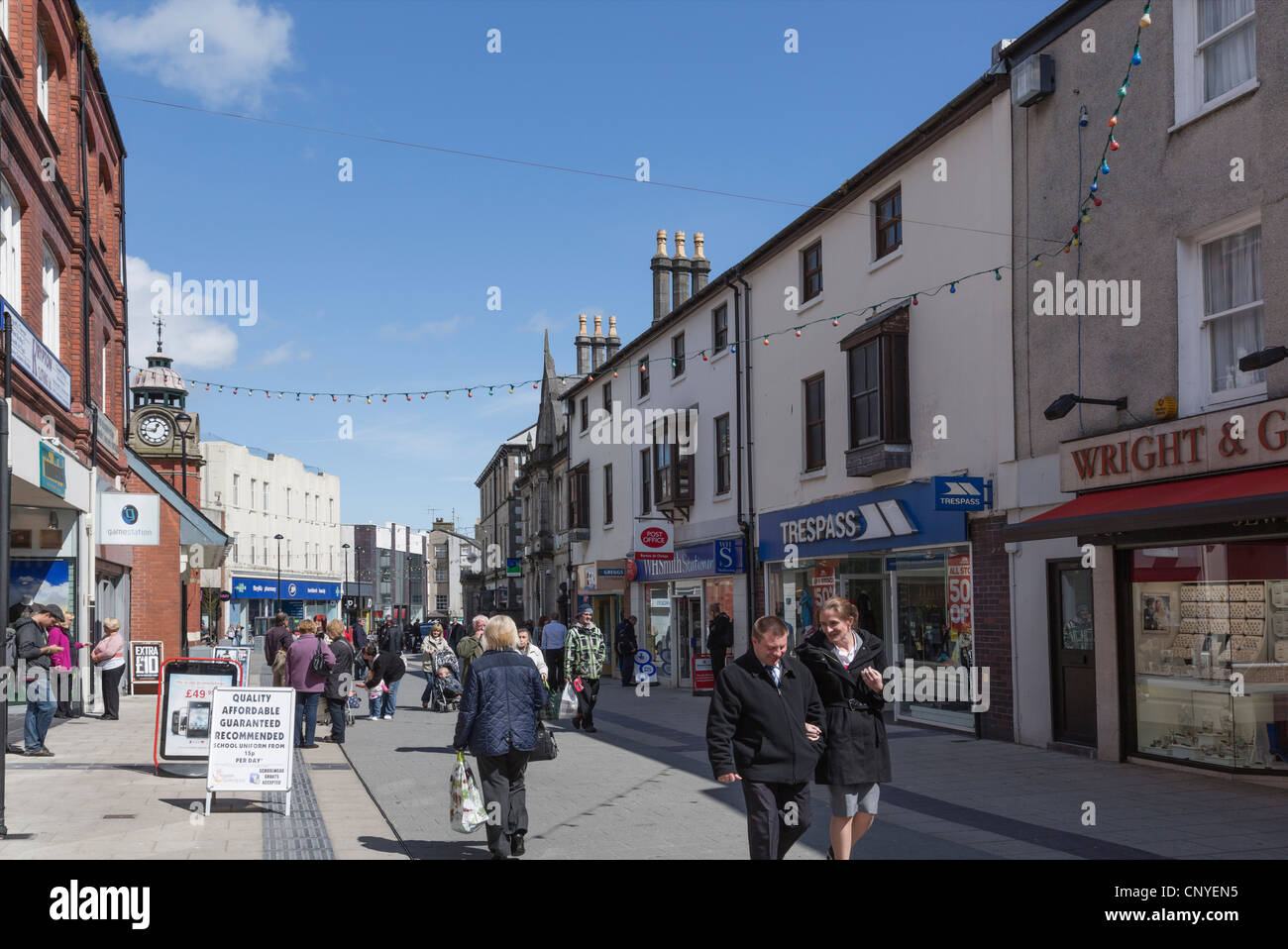 Street scene with people in the city centre shopping precinct. High Street, Bangor, Gwynedd, North Wales, UK. - Stock Image