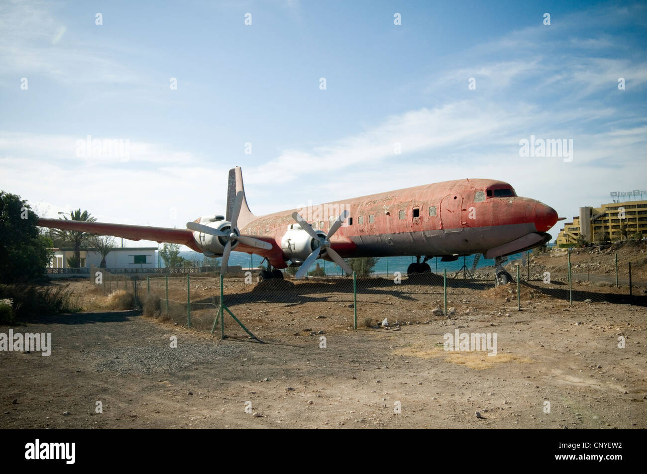 old plane planes airplane airplanes graveyard Douglas DC-6 rot rotting shell aluminum forlorn industrial history - Stock Image
