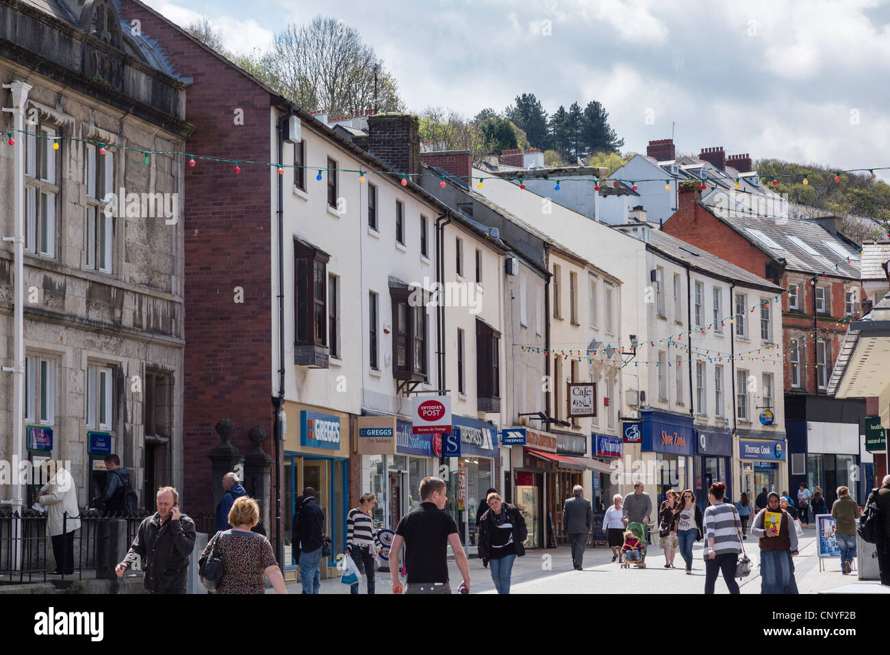 High Street, Bangor, North Wales, UK. Street scene busy with people in the city centre shopping precinct - Stock Image