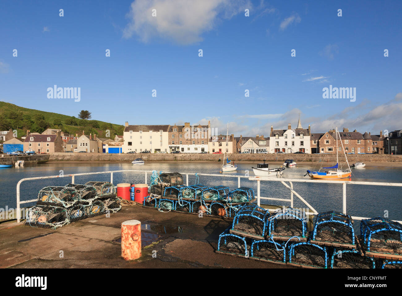 Lobster pots on the quayside of the small fishing port and harbour at Stonehaven, Aberdeenshire, Scotland, UK. - Stock Image
