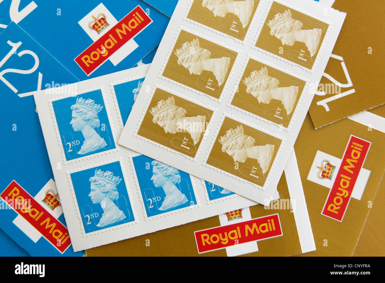 UK, Britain. Royal Mail first and second class postage stamps and stamp books - Stock Image