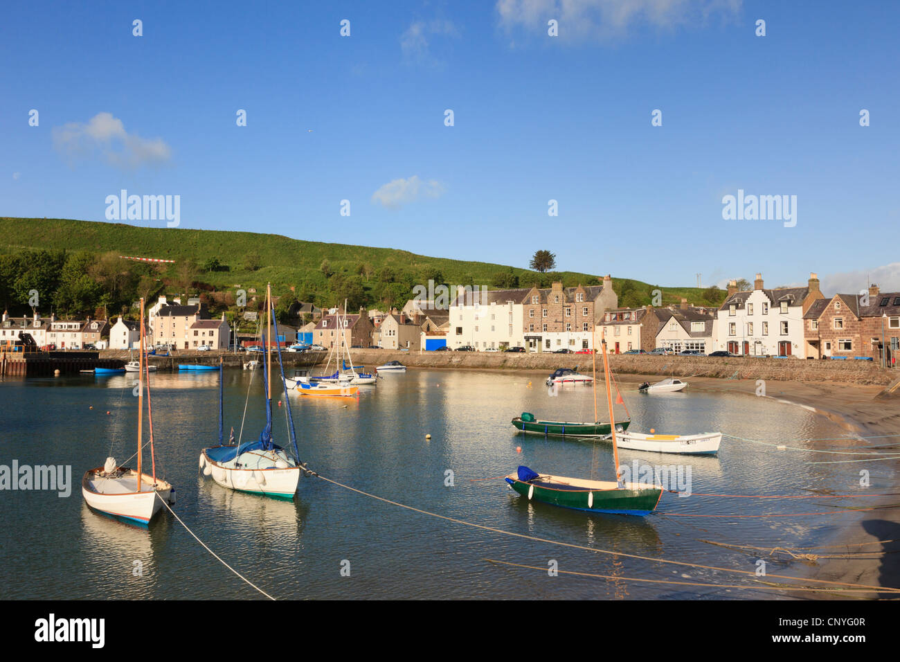 View across fishing port with small boats in harbour at Stonehaven, Aberdeenshire, Scotland, UK, Britain. - Stock Image