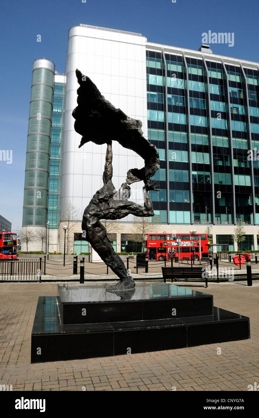 'Renaissance' statue by Maurice Blick, Leamouth bus terminal with modern building behind the site of the - Stock Image