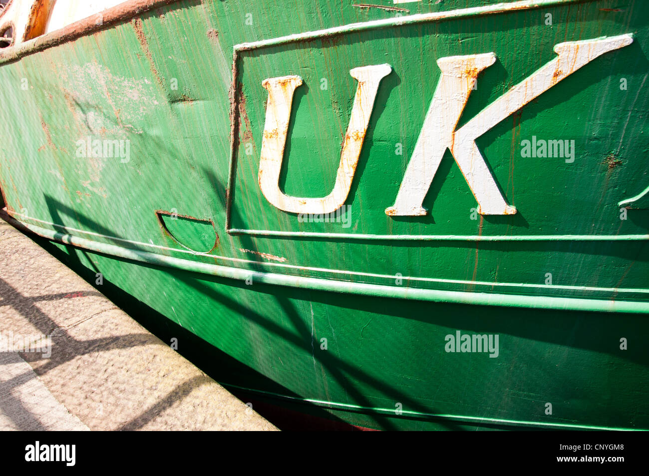 UK fishing industry. Vessel berthed at port. - Stock Image