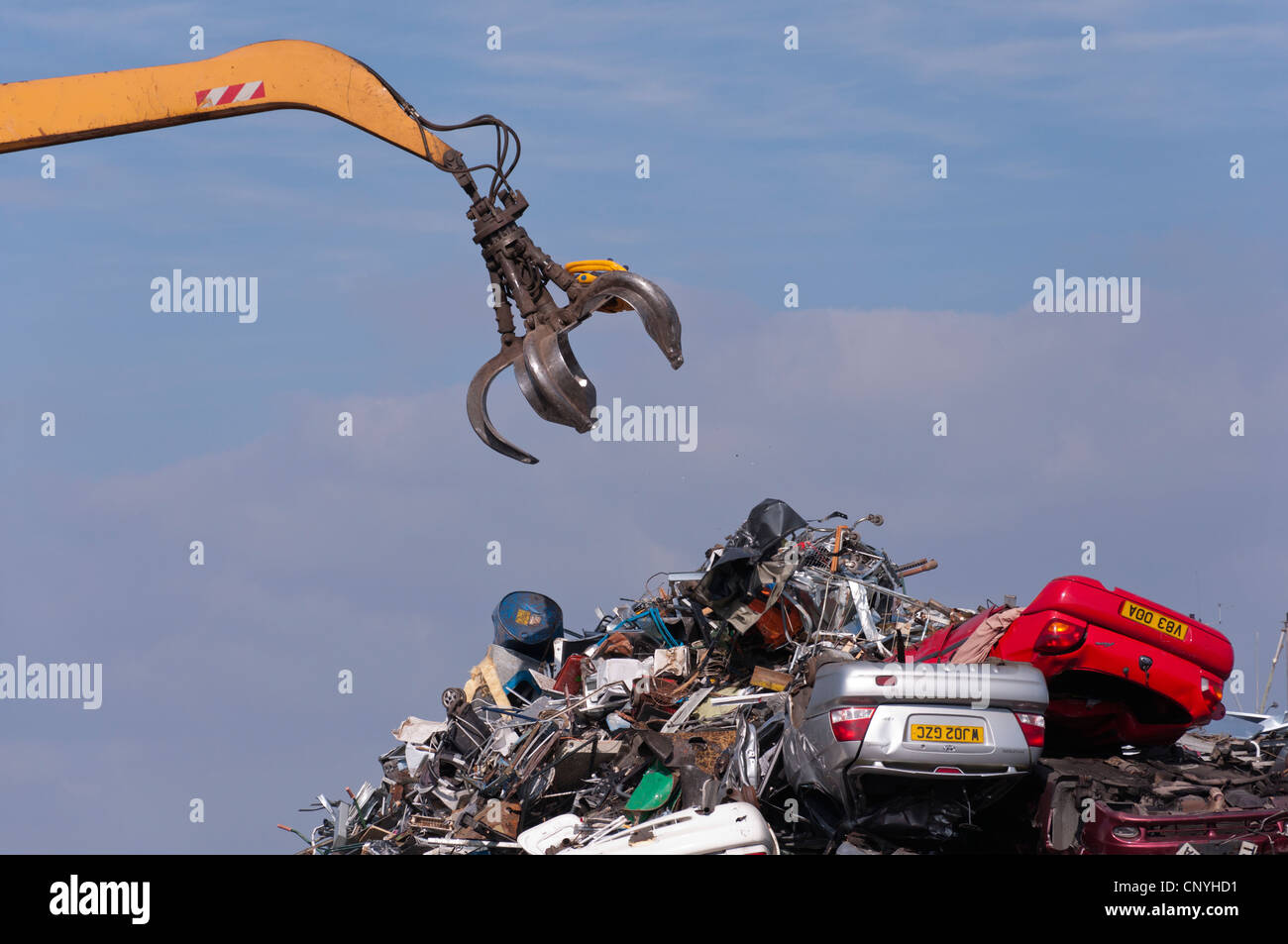 Scrap cars and metal at scrapyard recycler - Stock Image