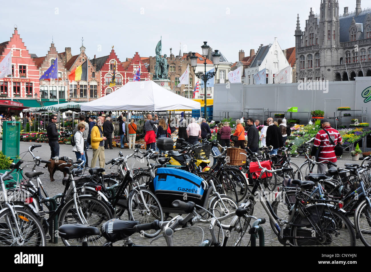 Belgium - Bruges - the Market Square - cycles - the most popular transport in the city - Stock Image
