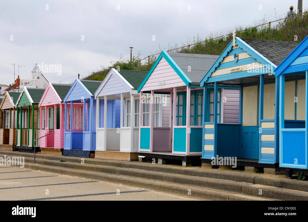 Suffolk - Southwold - line up of luxury beach huts - bright colours - immaculate - expensive - select - Stock Image