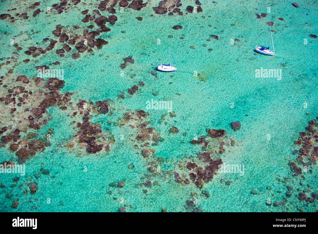 two little boats in turquoise water of Indian Ocean Stock Photo