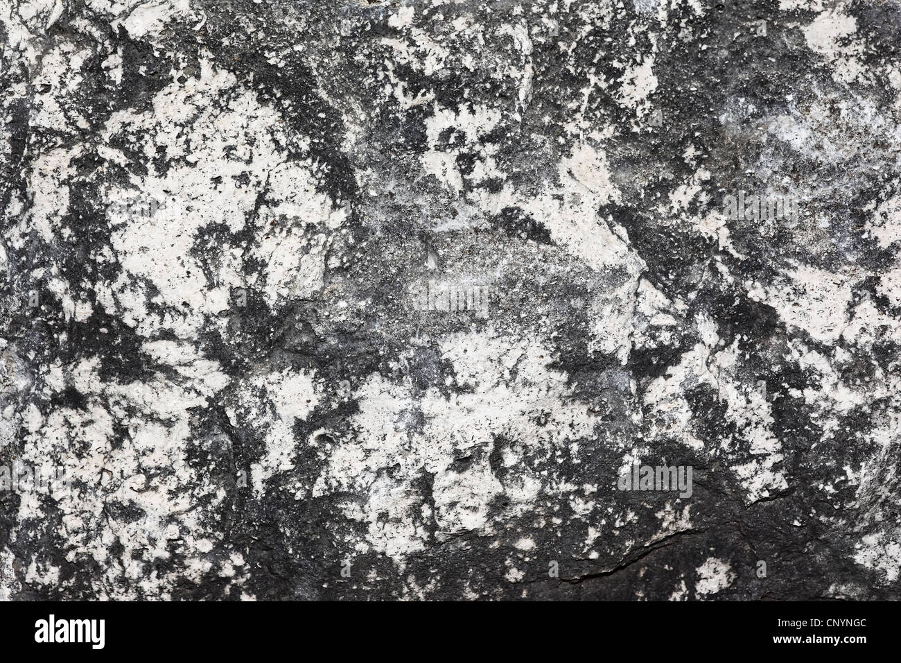 Old stone background textured wall pattern, grungy gray wallpaper - Stock Image