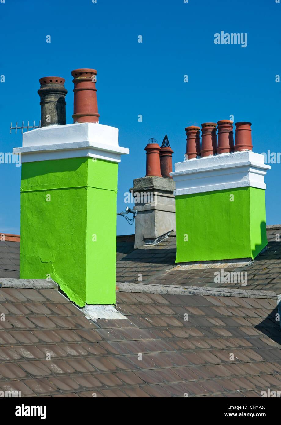 Green chimneys in Whitehead, Northern Ireland. - Stock Image