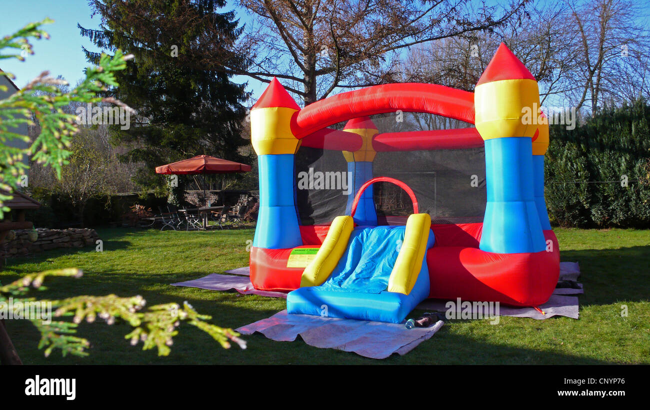 jumping castle in a garden - Stock Image