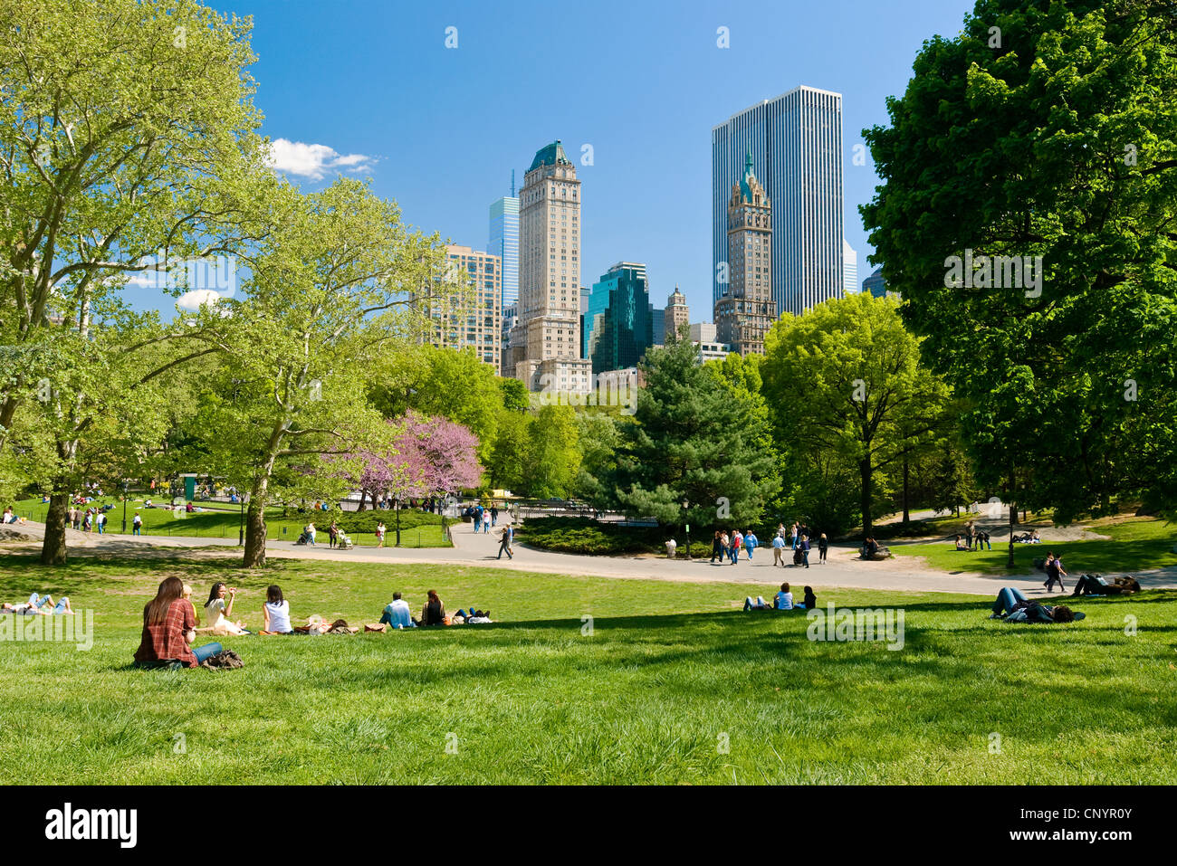 People relaxing in Central Park, New York City in spring season. - Stock Image