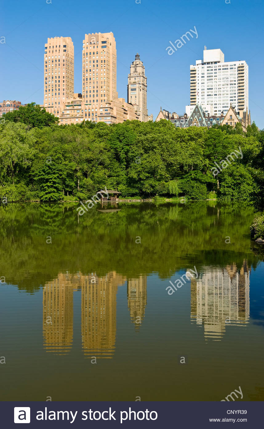 Central Park The Lake Central Park West Apartment Building The Dakota - Stock Image