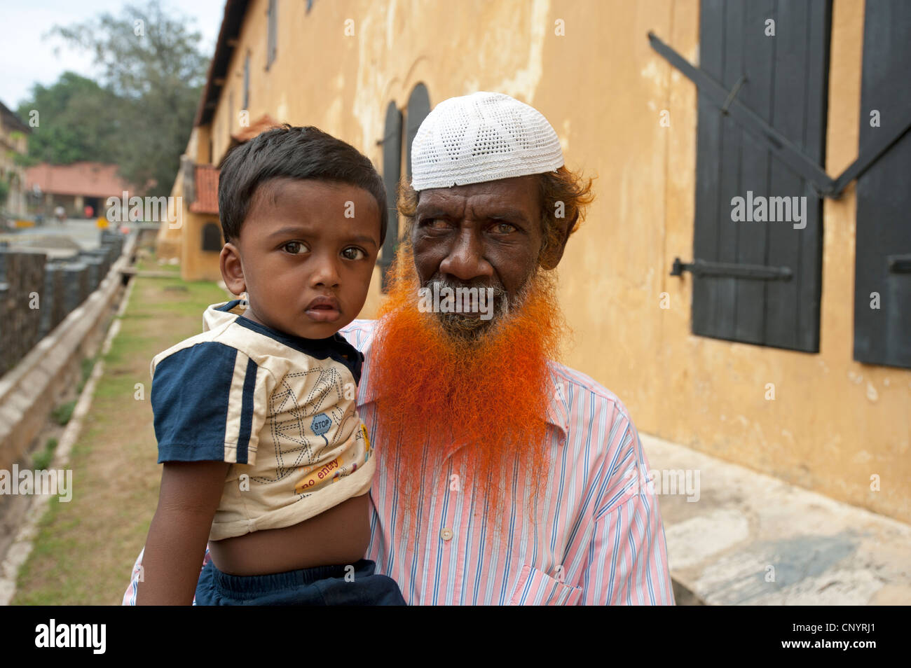 Muslim father with orange dyed beard and son Galle Fort Sri Lanka - Stock Image