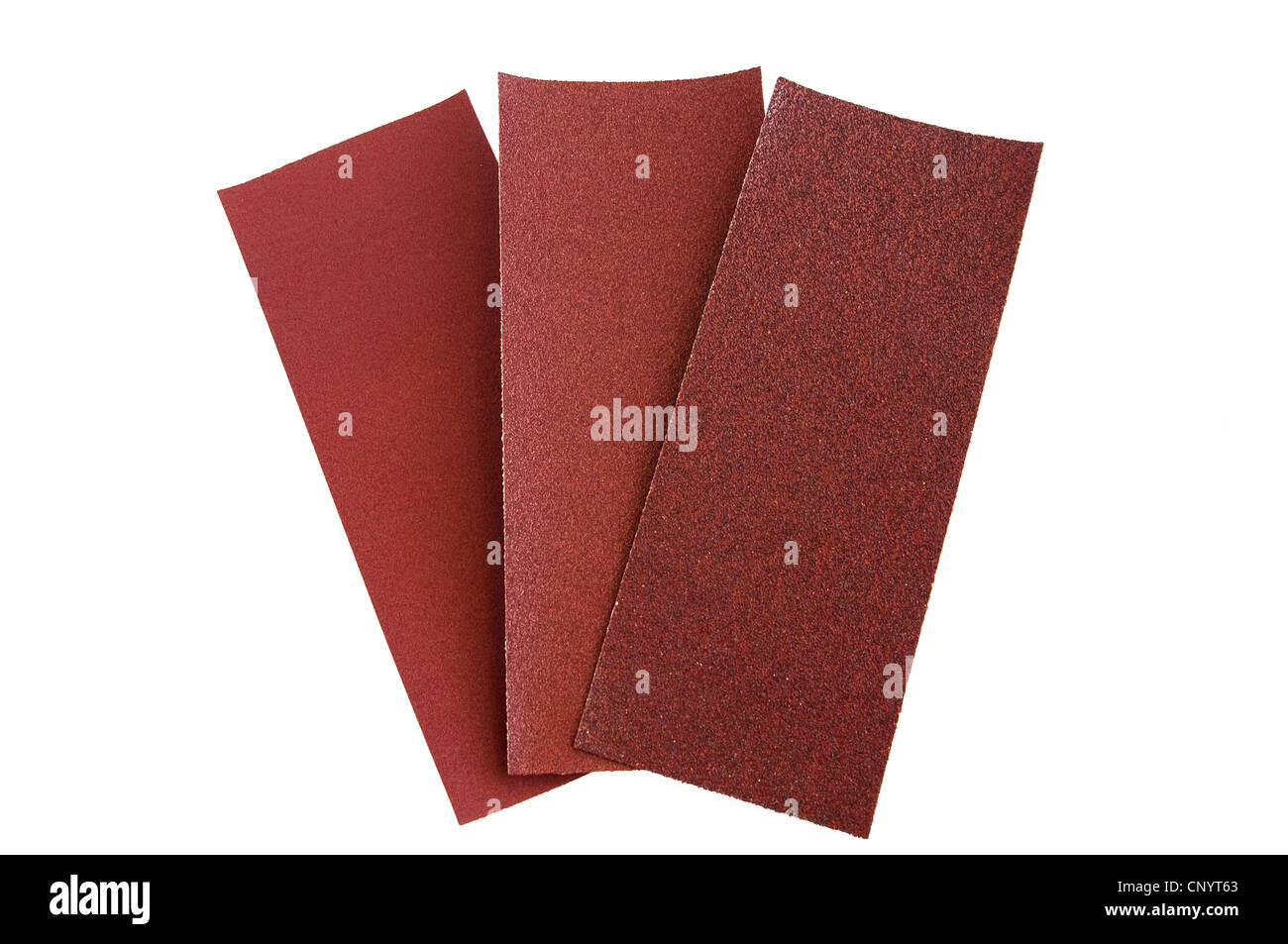 three different grit sandpaper on a white background - Stock Image