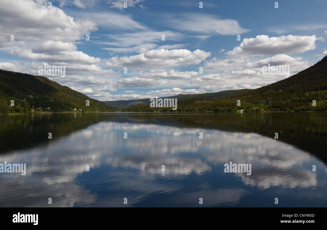 clouds reflecting in a quiet lake, Norway, Buskerud, Holasovice - Stock Image