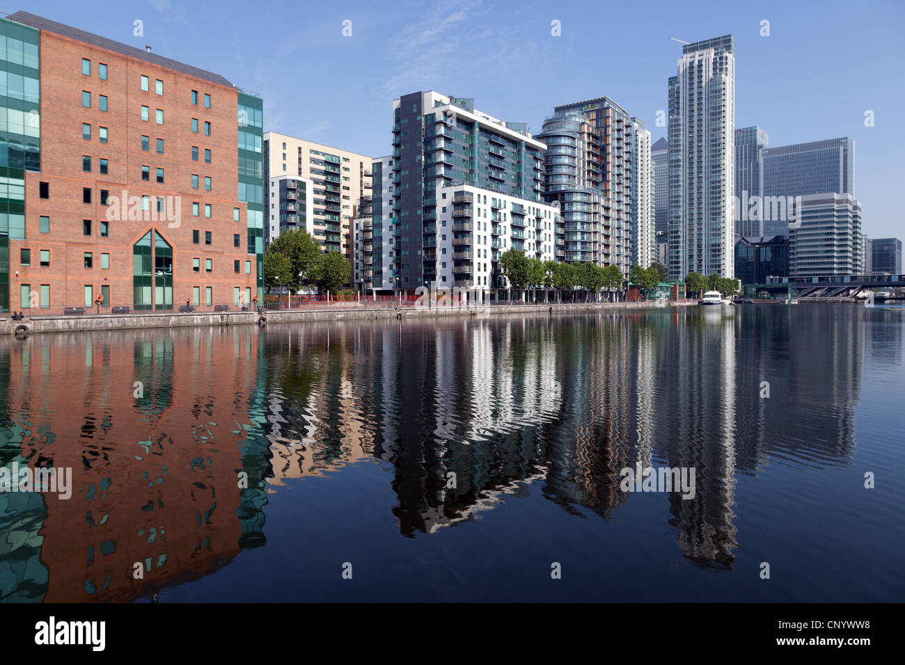Building reflected in water of old docks, Docklands, London - Stock Image