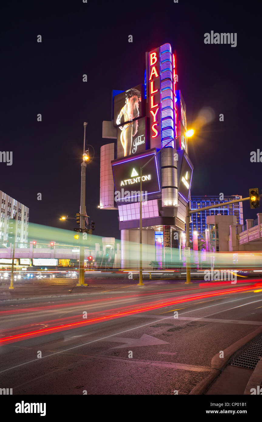 Long exposure street traffic scene with Ballys Hotel in background at Las Vegas Boulevard Stock Photo