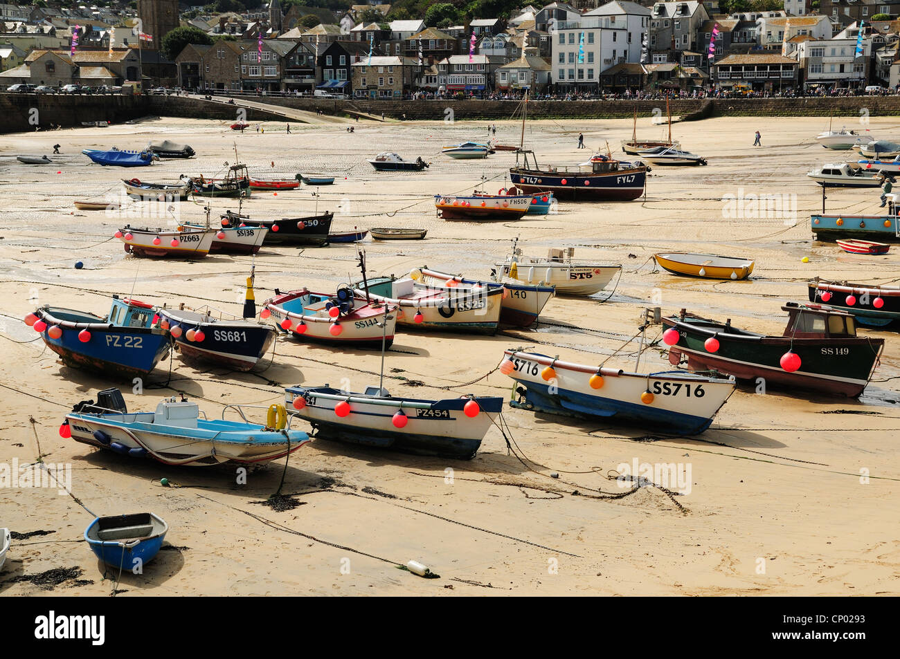 Boats seen at low tide in St Ives Harbour, Cornwall Stock Photo