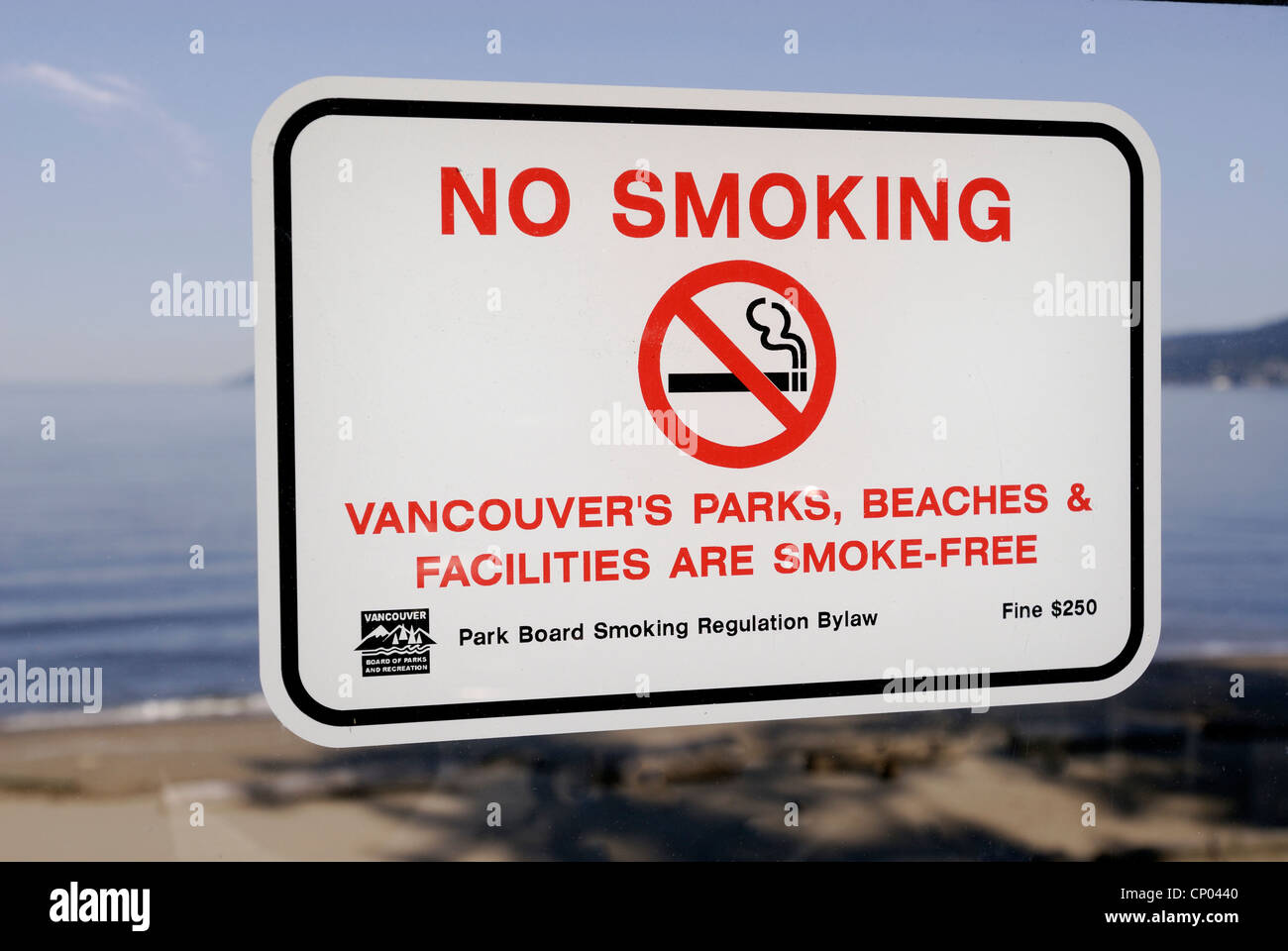 Posted sign warning against smoking in all parks and beaches in the city of Vancouver. - Stock Image