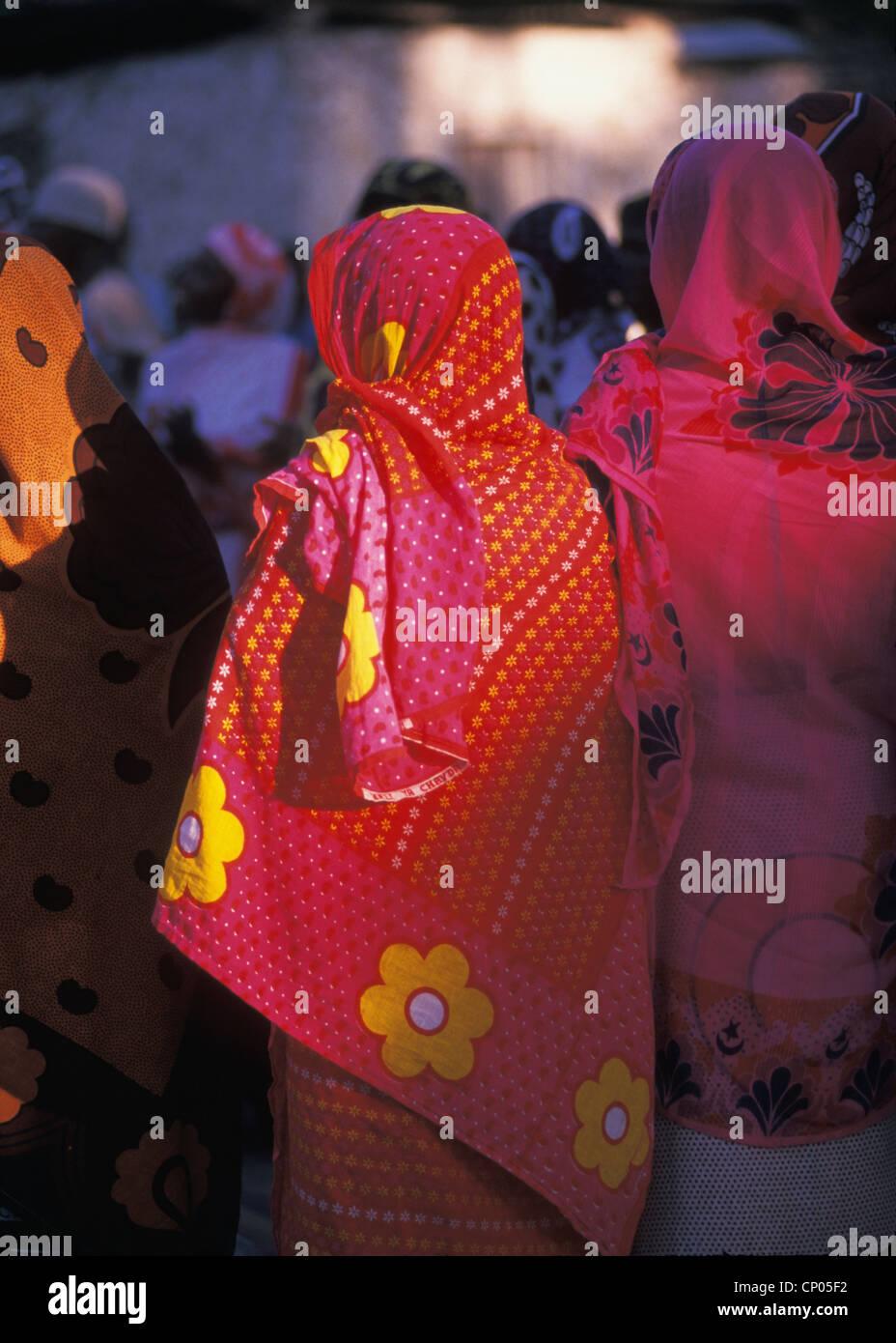 Zanzibari village women in colorful traditional robes in Nungwi village exorcism ceremony Zanzibar Tanzania - Stock Image