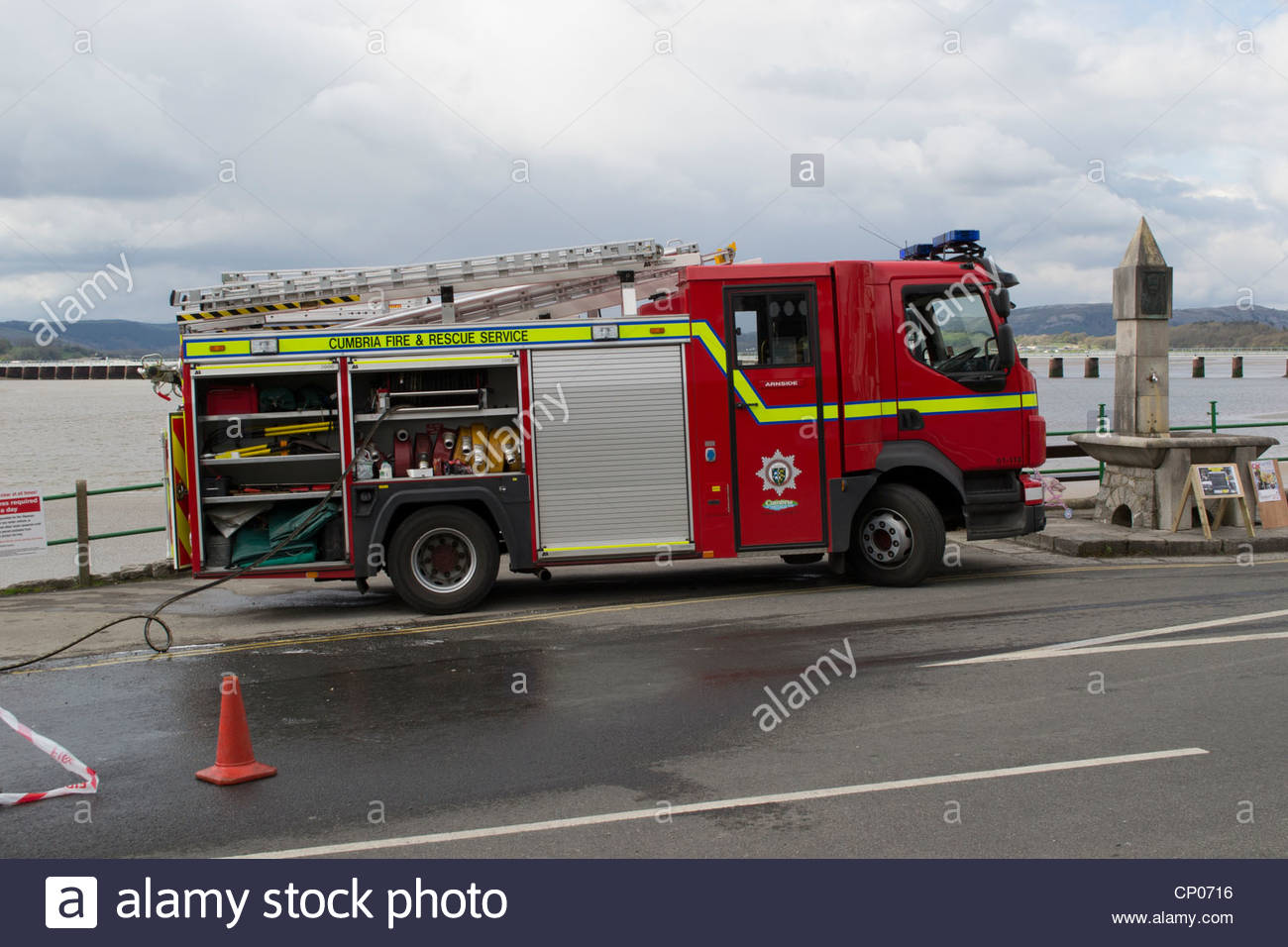 Washing cars using a fire engine in Arnside, Cumbria to raise money for charity - no water shortage in North West - Stock Image