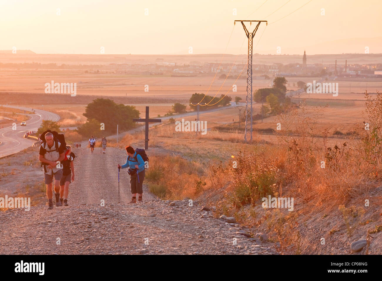 pilgrims on the Way of St. James having started from Santo Domingo de la Calzada with the sunrise, Spain, Basque - Stock Image