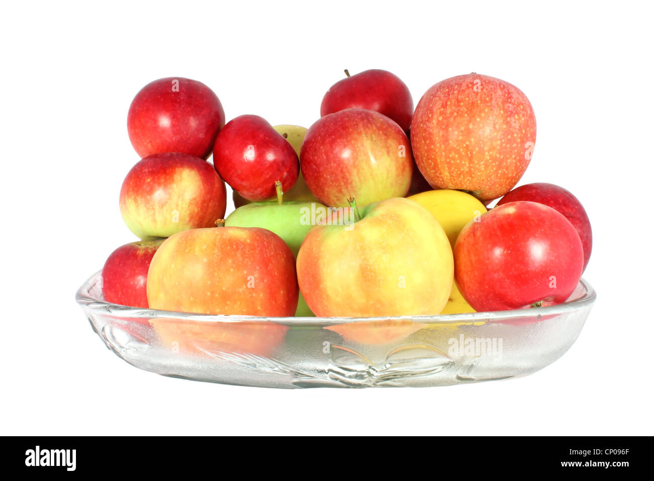 Diverse kind of apples in a glass bowl isolated on white - Stock Image