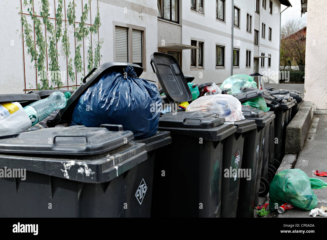 A line of rubbish bins outside a block of flats , Prien Chiemgau Upper Bavaria Germany - Stock Image