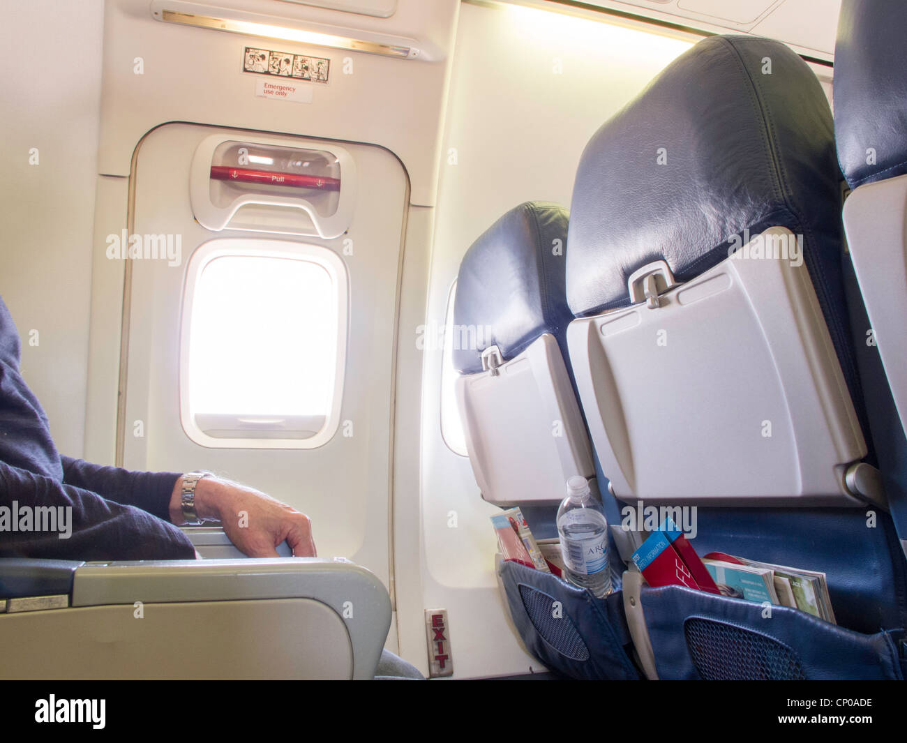 Male passenger sits in emergency exit row on airplane for Table exit fly