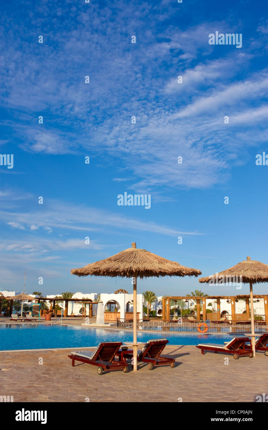 lounge chairs near swimming pool in resort, Egypt Stock Photo