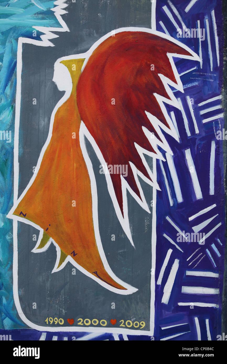 Berlin Wall East Side Gallery angel painting - Stock Image