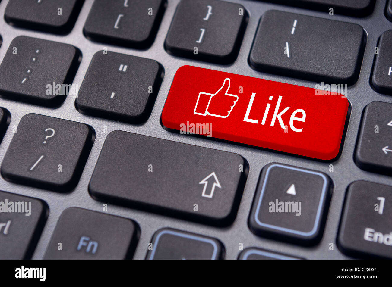 A like message on enter keyboard for social media concepts. - Stock Image