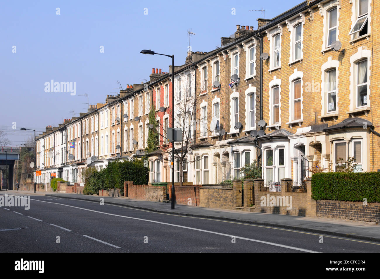 Long row of old three storey terraced flats & apartments without parked cars in Hackney London close to town - Stock Image