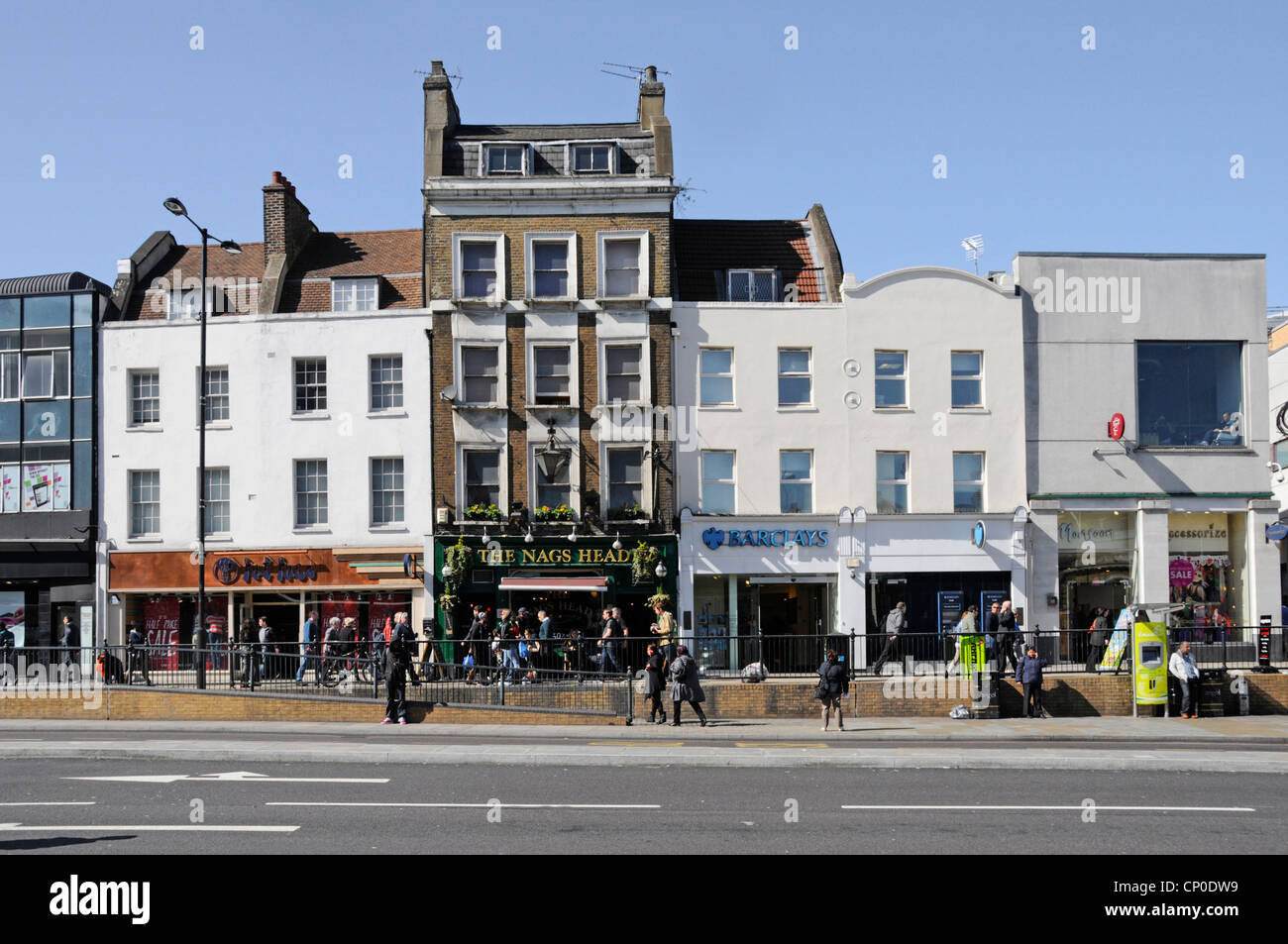 Upper Street shops and business premises including The Nags Head pub - Stock Image