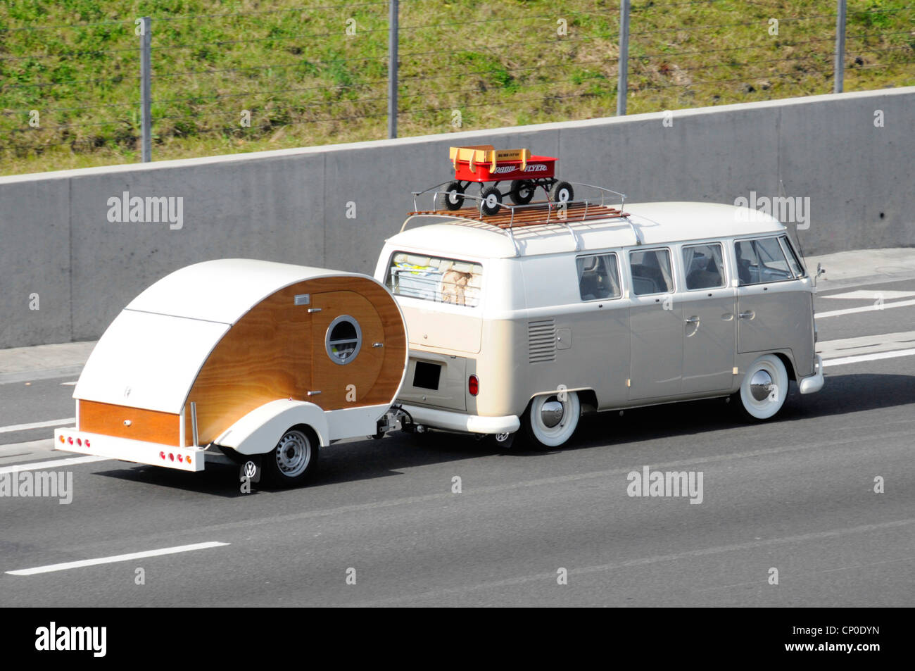 VW RV Campervan Motorhome With Roof Rack Towing Teardrop Micro Trailer Type Camper Caravan Along M25 Motorway Essex England UK