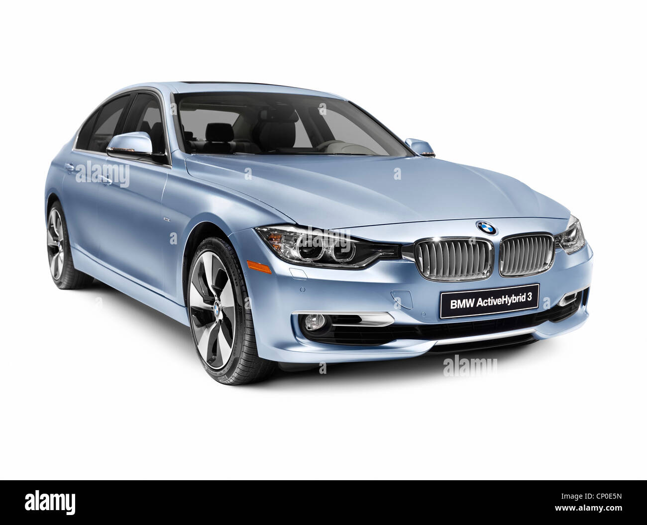 Blue 2012 BMW ActiveHybrid 3 hybrid car isolated on white background with clipping path Stock Photo