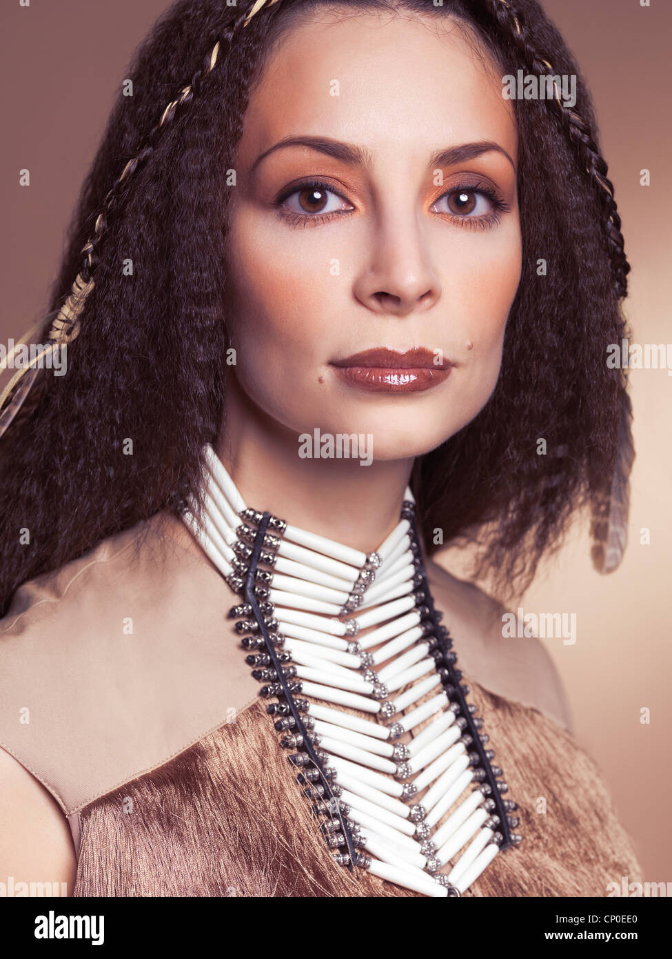 Artistic beauty portrait of a beautiful woman wearing aboriginal native necklace and accessories - Stock Image