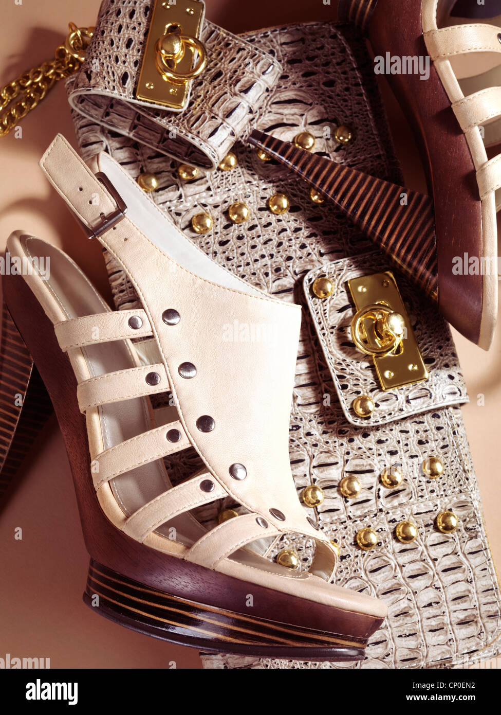 High heel platform shoes and a clutch. Fashion accessory still life. - Stock Image