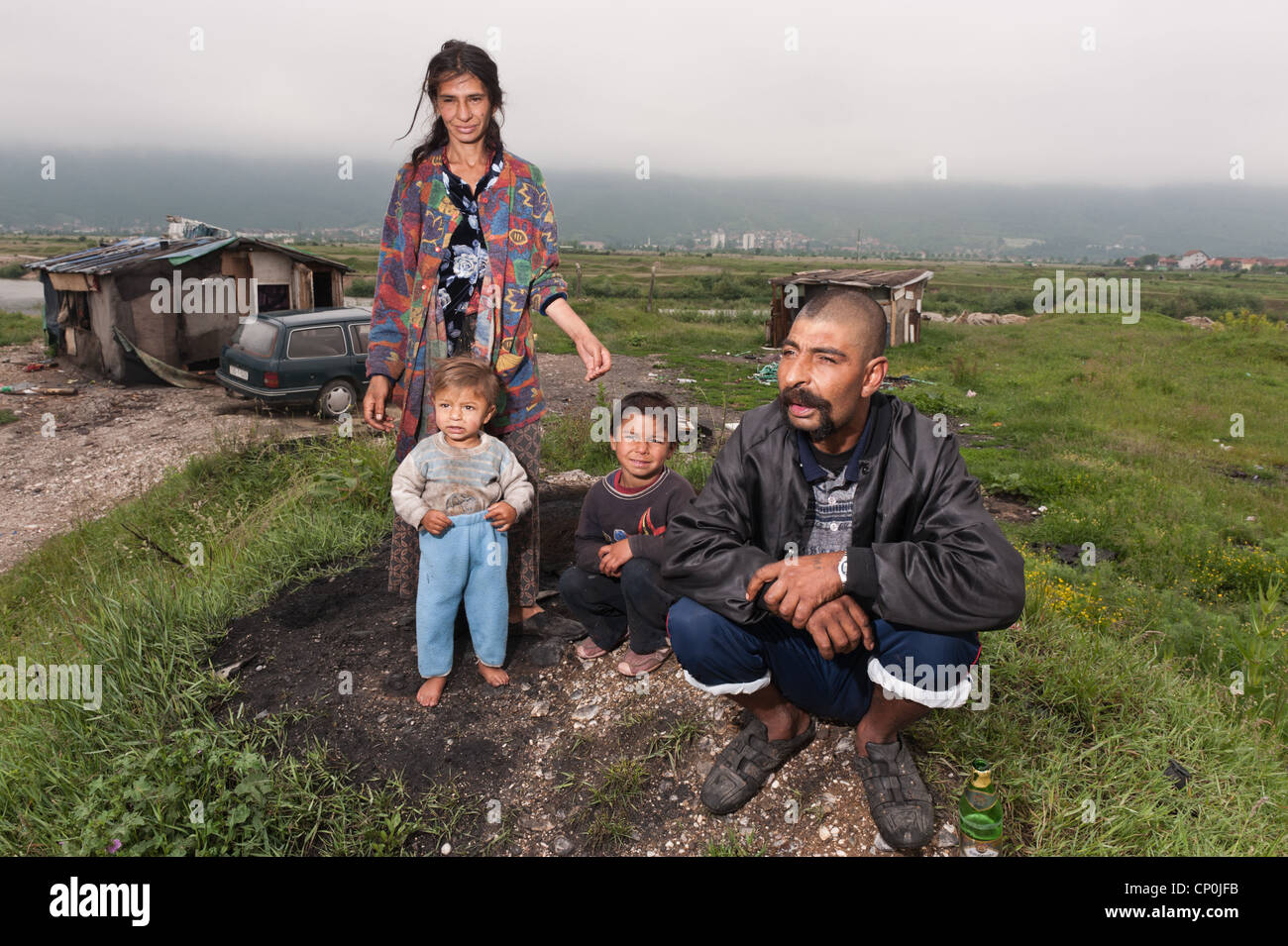 Roma family waiting for authorities to displace them to new house that authorities made for Roma people in outskirts - Stock Image